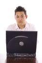 Asian guy sending an email shot of Stock Image