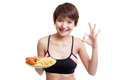 Asian healthy girl eat  french fries and  fired chicken  show OK Royalty Free Stock Photo