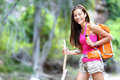 Asian hiking woman portrait female hiker in forest standing with walking stick looking at camera Royalty Free Stock Photography