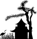 Asian house under pine tree crane reeds silhouette Stock Photo