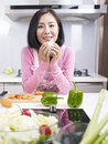 Asian housewife woman taking a break in kitchen Stock Photography