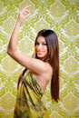 Asian Indian brunette girl with long hair dancing Royalty Free Stock Photos