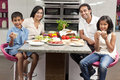 Asian Indian Parents Children Family Eating Meal Stock Photo