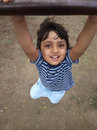 Asian Indian todder boy hanging swing having fun Royalty Free Stock Photos