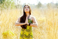 Asian indian woman praying hands  in golden field Royalty Free Stock Photo