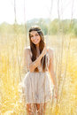 Asian indian woman walking in golden dried field Stock Image