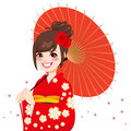 Asian japanese umbrella woman beautiful wearing gorgeous red kimono with delicate flowers holding Stock Photo