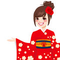 Asian japanese woman beautiful with red kimono holding palm up smiling Stock Photo