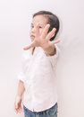 asian kid and hand raise stop written Royalty Free Stock Photo