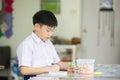 Asian kid looking at his craft at kindergarten Royalty Free Stock Photo