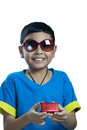 Asian kid wearing sunglass and hold small present box on white background Stock Photos
