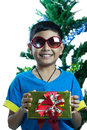 Asian kid wearing sunglass and hold small present box on white background Royalty Free Stock Photography