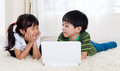 Asian kids little using laptop Royalty Free Stock Photos