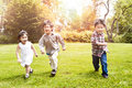 Asian kids running in park Royalty Free Stock Images