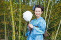 Asian kimono woman with bamboo grove cotton candy Stock Images