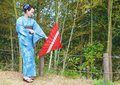 Asian kimono woman with bamboo grove japanese red traditional umbrella Royalty Free Stock Photography