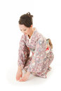 Asian kimono woman bow beautiful japanese sit in white background Royalty Free Stock Photography