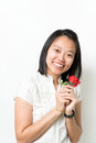 Asian lady hold red rose smile Stock Photo