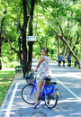 Asian lady riding bicycle biking in green park Royalty Free Stock Image