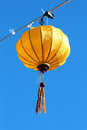 Asian lantern a colorful against a deep blue sky Stock Photo
