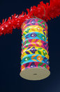 Asian lantern typical colorful paper hanged over a dark blue background Stock Photography
