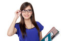 Asian librarian woman smiling beautiful young lady in dark framed glasses while holding some books Stock Image