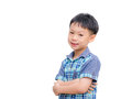 Asian little boy smiles on white background arms crossed isolated Royalty Free Stock Photos