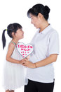 Asian Little Chinese Girl celebrating mother`s day with her mom Royalty Free Stock Photo