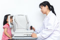 Kid ophthalmology - optometrist checking little child`s vision