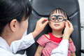 Asian Little Chinese Girl Doing Eyes Examination Through Auto re
