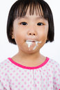 Asian Little Chinese Girl Eating Ice Cream Royalty Free Stock Photo