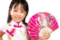 Asian little chinese girl holding oriental fan isolated on white bakground Royalty Free Stock Images