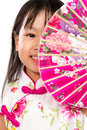 Asian little chinese girl holding oriental fan isolated on white bakground Stock Images