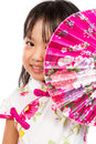 Asian little chinese girl holding oriental fan isolated on white bakground Stock Image