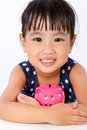 Asian Little Chinese Girl Hugging Piggy Bank Royalty Free Stock Photo