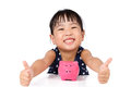 Asian Little Chinese Girl With Piggy Bank Royalty Free Stock Photo