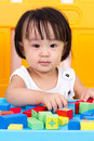Asian Little Chinese Girl Playing Wooden Blocks