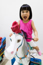 Asian Little Chinese Girl Riding on a Horse Royalty Free Stock Photo