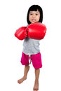 Asian Little Chinese Girl Wearing Boxing Glove With Fierce Expre Royalty Free Stock Photo