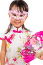 Asian little chinese girl wearing mask and holding oriental fan isolated on white bakground Royalty Free Stock Photos