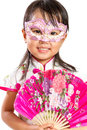 Asian little chinese girl wearing mask and holding oriental fan isolated on white bakground Stock Photo