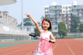 Asian little girl and bicycle Royalty Free Stock Image