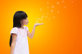 Asian little girl blowing soap bubbles Stock Image
