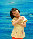 Asian little girl on blue background Royalty Free Stock Photo
