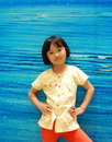 Asian little girl on blue background Royalty Free Stock Images