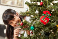 Asian little girl and Christmas tree Stock Images