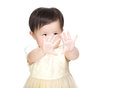 Asian little girl looking her hand Stock Photography