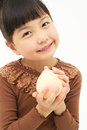 Asian little girl with peach isolated on white background Royalty Free Stock Image