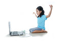 Asian little girl playing games with laptop computer and joystick controller