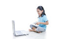 Asian little girl playing games with laptop computer and joystick controller isolated on white background with clipping path Royalty Free Stock Photo